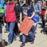 2018 IL Out of the Darkness Walk (students walking with signs)