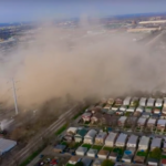A drone video showed how the dust cloud spread from the Crawford demolition site and descended onto Little Village homes. (Alejandro Reyes/YouTube)