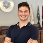 Nick Lisle smiling in court room